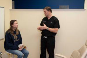 Frey talking to teen patient