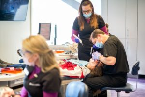 Dr. Frey working with kids teeth.